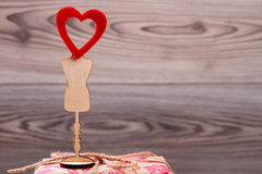 Red heart on wooden stand. Royalty Free Stock Image