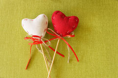 Red heart on wooden stick. Colored beautiful stock images
