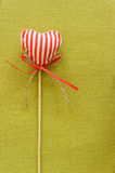 Red heart on wooden stick. Colored beautiful stock photo