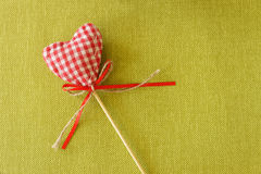 Red heart on wooden stick. Colored beautiful royalty free stock photos