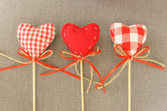 Red heart on wooden stick. Gray background Stock Images