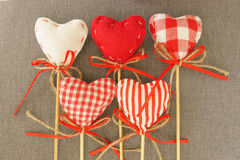 Red heart on wooden stick. Gray background stock photos