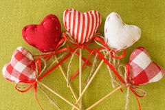 Red heart on wooden stick. Takes checkered colored Stock Image