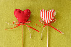 Red heart on wooden stick. Takes checkered colored stock photo