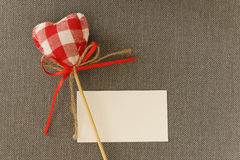 Red heart on wooden stick. White card Royalty Free Stock Image