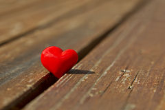Red heart on a wooden surface Royalty Free Stock Photos