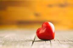 Red heart on wooden table. Royalty Free Stock Image