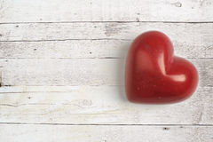Red heart on a wooden table Royalty Free Stock Photos