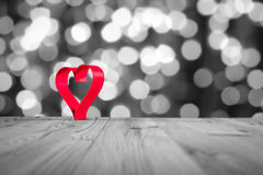 Red Heart on wooden table, on a whiteblack background .Valentine`s day theme . High resolution photo. Stock Photos