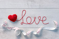 Red heart and word love of red wool yarn Royalty Free Stock Images