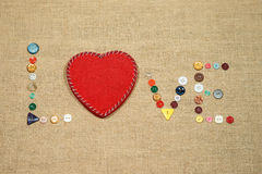 Red heart and word love writing with sewing buttons Stock Photo