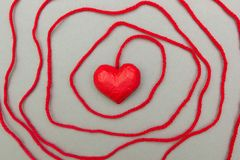 Red heart wrapped around with rope stock images