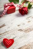 Red heart, wrapped gift with ribbon and rose for Valentines Day, copy space for text Stock Images