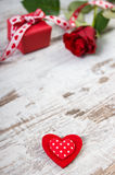 Red heart, wrapped gift with ribbon and rose for Valentines Day, copy space for text Stock Photo