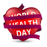 Red heart wrapped with a satin ribbon to the world health day. Royalty Free Stock Images