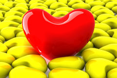 Red heart among the yellow. Stock Images