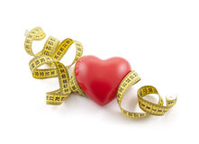 Red heart with yellow tape measure Royalty Free Stock Images