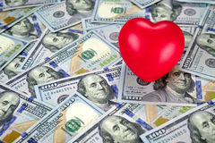 Red hearth on top of new one hundred dollar bills Stock Images