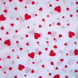 Red Hearts. On a white textile Vector Illustration
