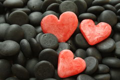 Red hearts. Three red herts on a black stones Stock Images
