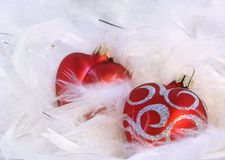 Red hearts. And white feathery background royalty free stock photo