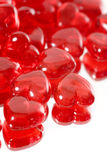 Red hearts. A pile of miniature red glass hearts stock photo