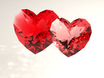 Red hearts. A pair of ruby ​​hearts on a white background Stock Photo