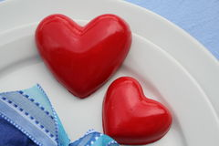 Red hearts. Handmade red hearts on dinner plate Royalty Free Stock Photography
