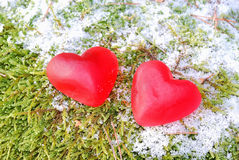 Red hearts. Red jelly hearts on the snow Stock Photos
