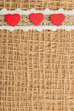 Red hearts on abstract cloth background Stock Photo