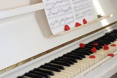 Red hearts adorn piano keys. Valentine`s Day . Red hearts adorn piano keys Valentine`s Day Royalty Free Stock Images