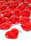 Red hearts as background. Red hearts on white background royalty free stock images