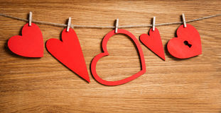 Red hearts as symbol of love on wood with copy space. Valentines day background. Royalty Free Stock Photo