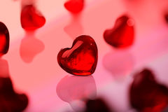 Red hearts background. Red glass heart shape against others Stock Photos
