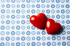 Red hearts background. Two read hearts over blue background Stock Photography