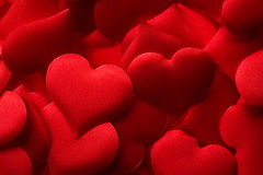 Red hearts background. Backgrounds and textures: red hearts background, suitable for Valentine`s day or wedding or some else romantic event Royalty Free Stock Photography