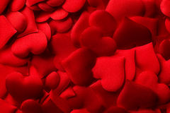 Red hearts background. Backgrounds and textures: red hearts background, suitable for Valentine`s day or wedding or some else romantic event Stock Photo