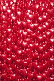 Red hearts background. The beads in the shape of heart Royalty Free Stock Image