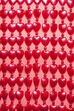 Red hearts background. The beads in the shape of heart Royalty Free Stock Images