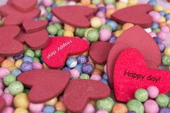 Red hearts background happy day sign Royalty Free Stock Images