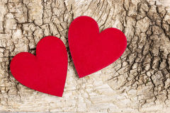 Red hearts on bark background. Symbol of love Royalty Free Stock Photos