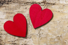 Red hearts on bark background. Symbol of love Stock Photo