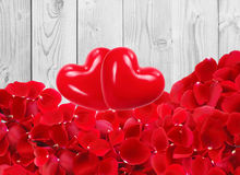 Red hearts with beautiful red rose petals on white wooden Royalty Free Stock Photography