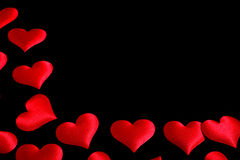 Red hearts on black background Stock Photo