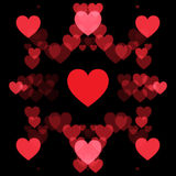 Red hearts and black background. Abstract shape Royalty Free Stock Image