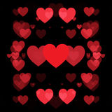 Red hearts and black background. Abstract shape Stock Photography