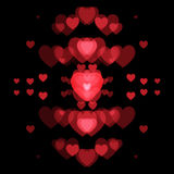Red hearts and black background. Abstract shape Royalty Free Stock Images