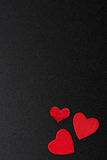Red hearts on a black background Stock Photo