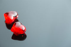 Red hearts on black table. Royalty Free Stock Photo