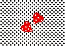 Red hearts black white polka dot background. Red hearts on black white polka dot background Royalty Free Stock Photo